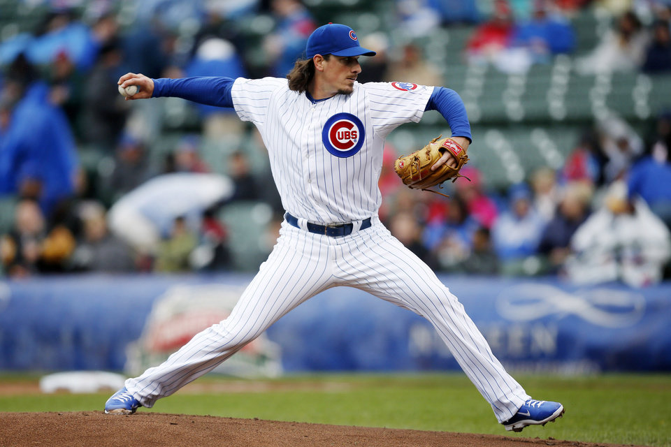Photo - Chicago Cubs starting pitcher Jeff Samardzija delivers against the Milwaukee Brewers during the first inning of a baseball game on Friday, May 16, 2014, in Chicago. (AP Photo/Andrew A. Nelles)