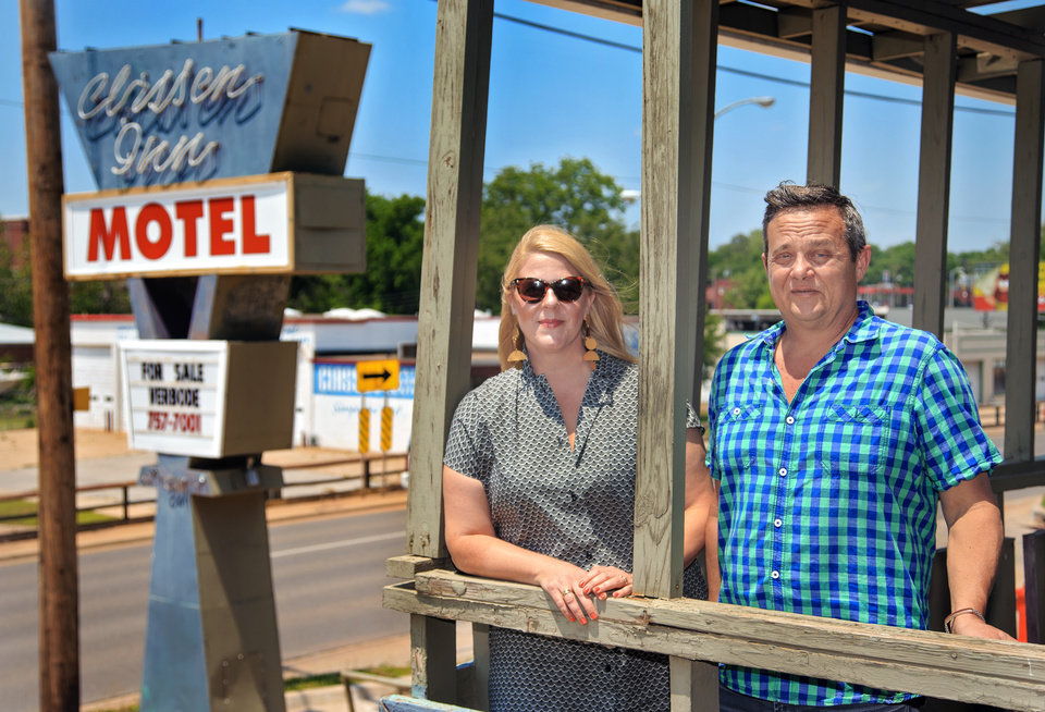 Photo -  Aimee Ahpeatone and Steve Mason, shown in this May photo, stand on a patio that could be turned into a bar or lounge as part of redevelopment of the Classen Inn at 820 N Classen Blvd. [Photo by Chris Landsberger, The Oklahoman Archives]