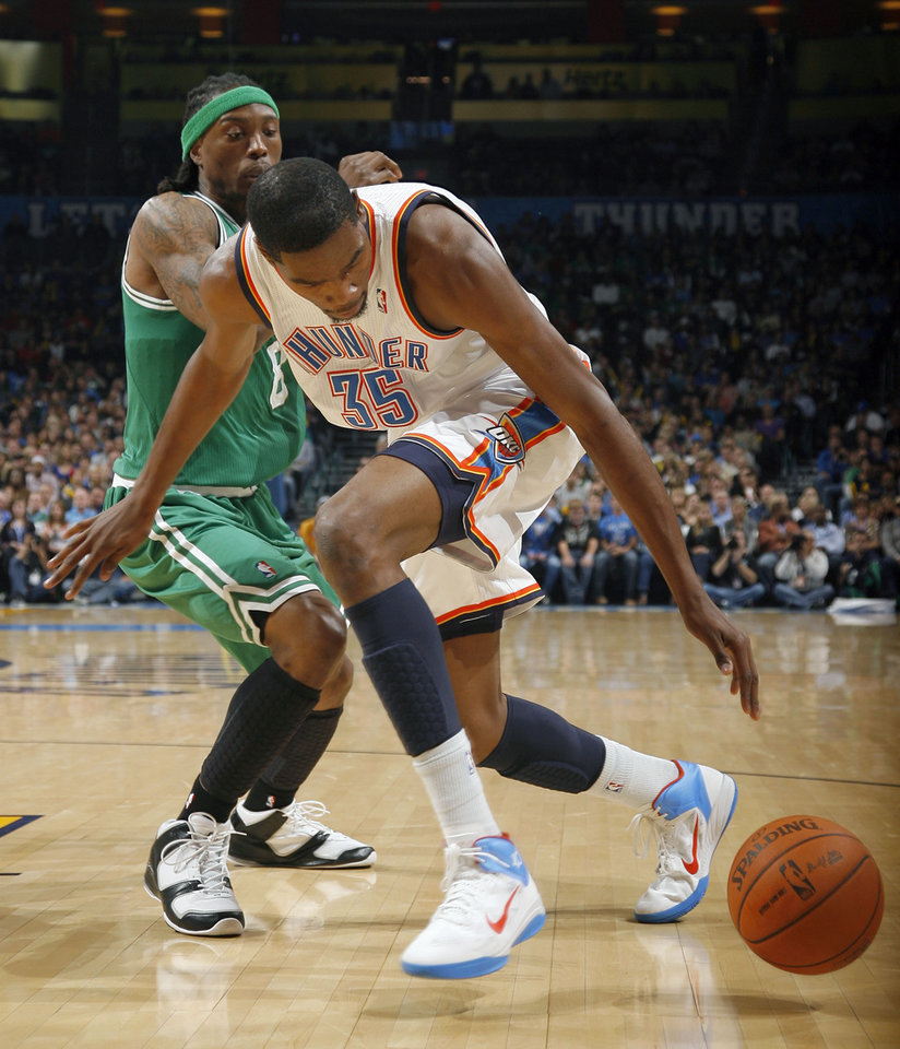 Oklahoma City\'s Kevin Durant (35) looses the ball as Boston\'s Marquis Daniels (8) defens during the NBA game between the Oklahoma City Thunder and the Boston Celtics, Sunday, Nov. 7, 2010, at the Oklahoma City Arena. Photo by Sarah Phipps, The Oklahoman