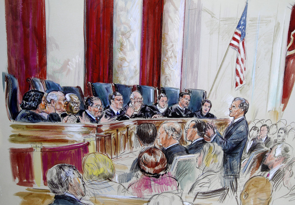 Photo - Solicitor General Donald B. Verrilli, Jr., speaks in front of the Supreme Court in Washington, Tuesday, March 27, 2012, as the court continued hearings on the health care law signed by President Barack Obama.  Justices, seated from left are, Sonia Sotomayor, Stephen Breyer, Clarence Thomas, Antonin Scalia, Chief Justice John Roberts, Anthony Kennedy, Ruth Bader Ginsburg Samuel Alito and Elana Kagan. (AP Photo/Dana Verkouteren) ORG XMIT: DCCD121