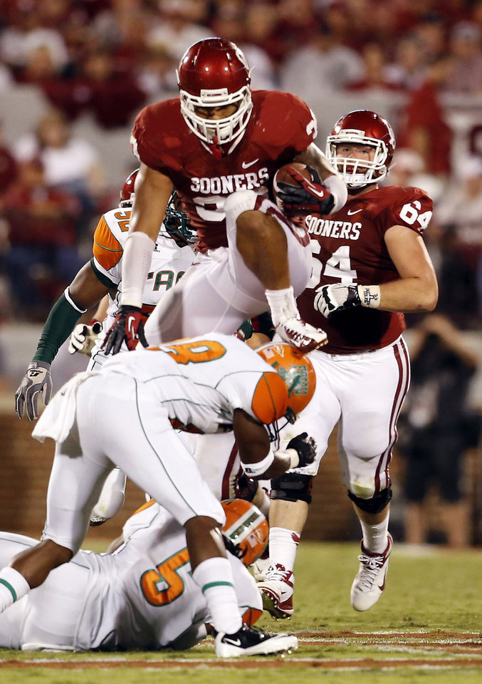 Trey Millard (33) leaps over defenders during the second half of the college football game between the University of Oklahoma Sooners (OU) and Florida A&M Rattlers at Gaylord Family-Oklahoma Memorial Stadium in Norman, Okla., Saturday, Sept. 8, 2012. Photo by Steve Sisney, The Oklahoman