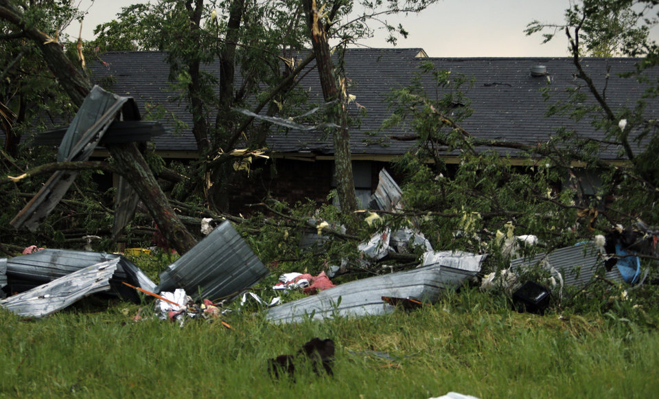 Photo - Debris is strewn around property after a tornado ripped through Bridge Creek, Okla. on Wednesday, May 6, 2015.  Photo by Steve Sisney, The Oklahoman