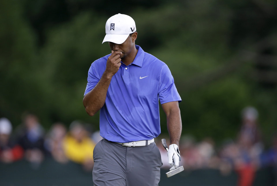 Photo - Tiger Woods walks down the second fairway after hitting out of a bunker during the first round of the U.S. Open golf tournament at Merion Golf Club, Thursday, June 13, 2013, in Ardmore, Pa. (AP Photo/Darron Cummings)
