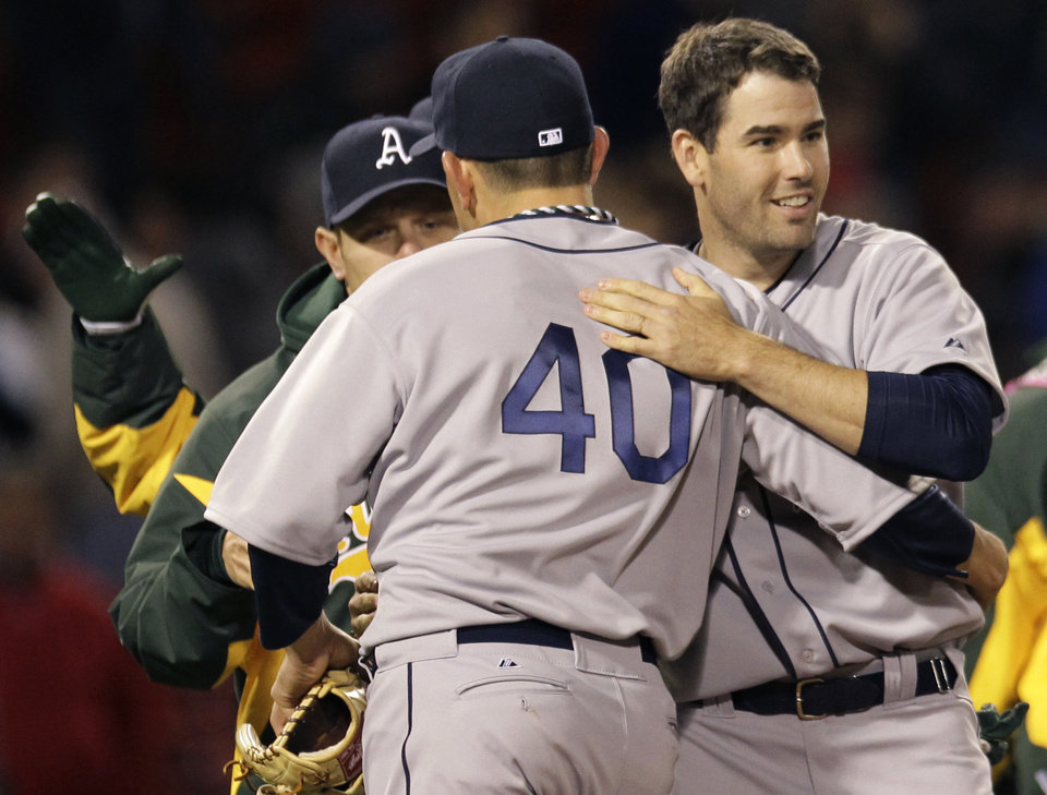 Oakland Athletics' Seth Smith, right, celebrates with closer Brian Fuentes (40) after the Athletics defeated the Boston Red Sox 4-2 in a baseball game at Fenway Park in Boston, Wednesday, May 2, 2012. (AP Photo/Elise Amendola)