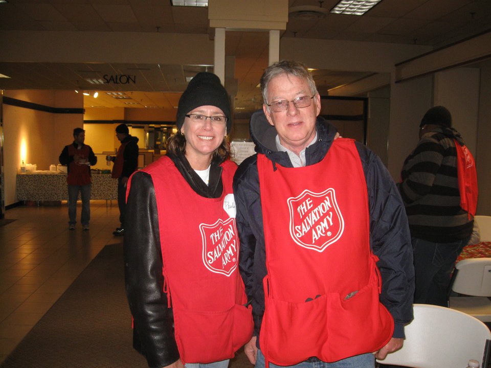 "Business writer Paula Burkes partnered with Bill Clark, of Rose State College, as a volunteer ""runner"" at the Salvation Army's toy distribution last week. PHOTO PROVIDED <strong></strong>"