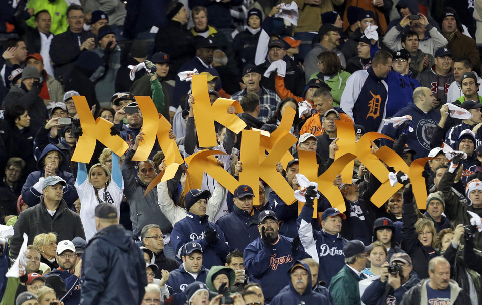 Photo -   Detroit Tigers fans hold up strikeout K's for starting pitcher Justin Verlander during the fifth inning of Game 1 of the American League division baseball series against the Oakland Athletics, Saturday, Oct. 6, 2012, in Detroit. (AP Photo/Paul Sancya)