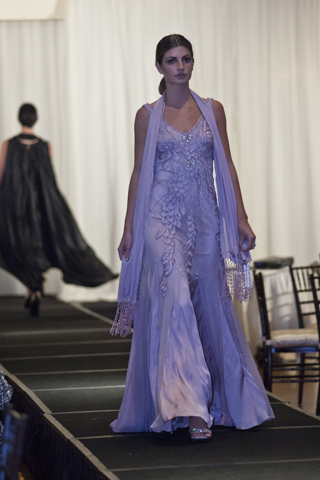 Photo - Model Amanda H. is wearing a lavender evening gown by Sue Wong at the Liberte runway show to benefit cystic fibrosis, hosted by Merrill Lynch Wealth Management. Photo provided.