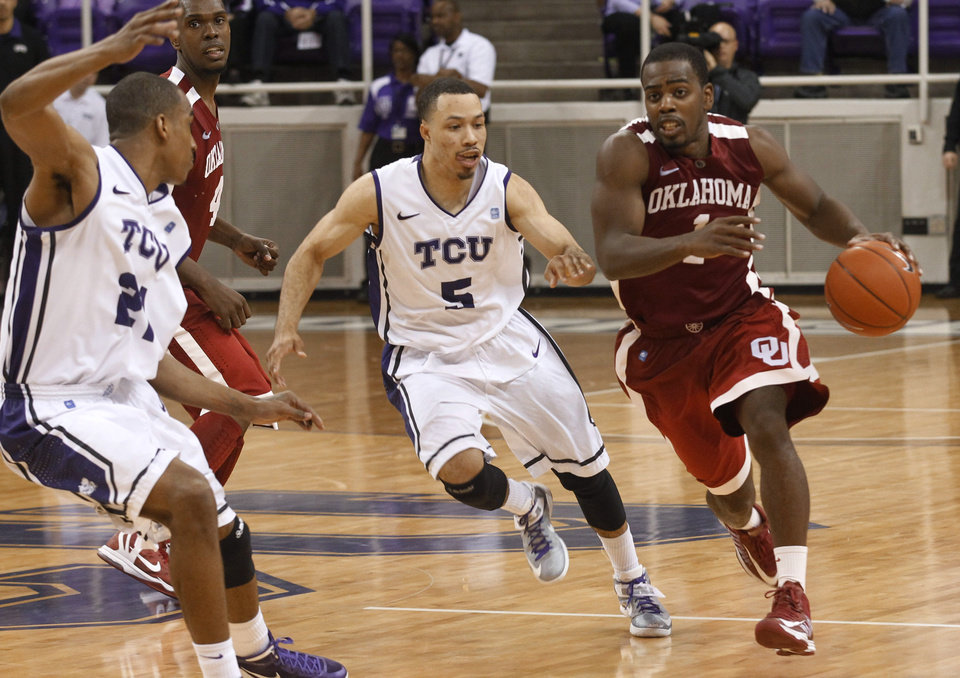 Oklahoma guard Sam Grooms (1) brings the ball up against TCU guard Kyan Anderson (5) in the final seconds of of an NCAA college basketball game Saturday, March 9, 2013, in Fort Worth, Texas. (AP Photo/Fort Worth Star-Telegram, Rodger Mallison) ORG XMIT: TXFOR403