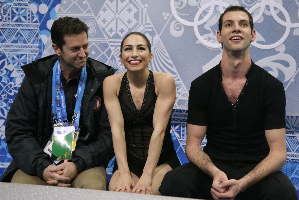 Photo - Marissa Castelli and Simon Shnapir of the United States wait in the results area after competing in the pairs short program figure skating competition at the Iceberg Skating Palace during the 2014 Winter Olympics, Tuesday, Feb. 11, 2014, in Sochi, Russia. (AP Photo/Darron Cummings)