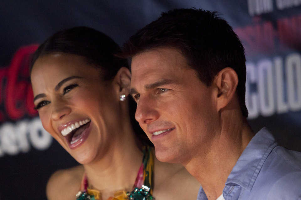 U.S actor Tom Cruise, right, and U.S actress Paula Patton poses for photos at the red carpet for the Premiere of Mission Impossible Ghost Protocol in Rio de Janeiro, Brazil, Wednesday Dec.  14, 2011. (AP Photo/Felipe Dana) ORG XMIT: XFD119