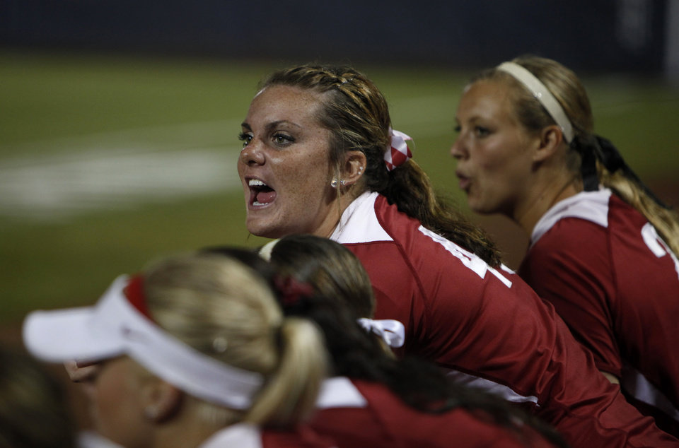 Photo - Oklahoma's Lauren Chamberlain (44) cheers from the dugout during Game 3 of the Women's College World Series softball championship between OU and Alabama at ASA Hall of Fame Stadium in Oklahoma City, Wednesday, June 6, 2012.  Photo by Garett Fisbeck, The Oklahoman