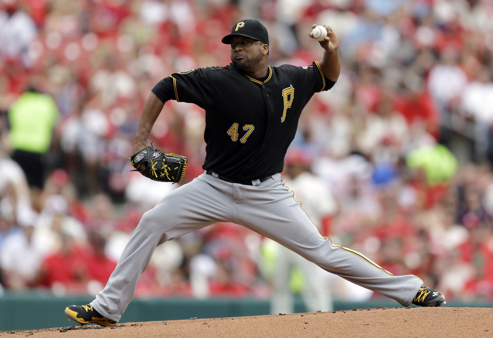 Photo - Pittsburgh Pirates starting pitcher Francisco Liriano throws during the first inning of a baseball game against the St. Louis Cardinals on Saturday, April 26, 2014, in St. Louis. (AP Photo/Jeff Roberson)