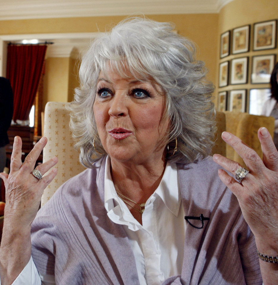Photo - FILE - In this Dec. 30, 2010 file photo, Paula Deen speaks in Pasadena, Calif. Sears Holdings Corp. announced Friday, June 28, 2013, that it is cutting ties with Southern celebrity chef Deen, adding to the list of companies severing their relationship following revelations that Deen used racial slurs in the past. (AP Photo/Nick Ut, File)