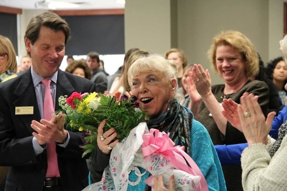 Photo -  Florence Birdwell accepts a bouquet in recognition of her 65 years of service as a voice professor at Oklahoma City University. Birdwell — who's trained Kristin Chenoweth, Kelli O'Hara and other Broadway stars — once dreamed of being a famous singer herself, but reinvented herself as a teacher, after an infection took her singing voice. Photos provided    -  PHOTO PROVIDED