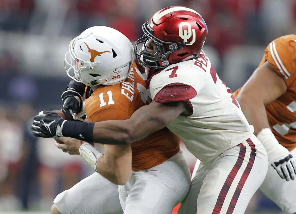 Photo - Oklahoma's Ronnie Perkins brings down Texas' Sam Ehlinger for a loss in the 2018 Big 12 Championship Game. Oklahoma won 39-27. [Photo by Bryan Terry, The Oklahoman]