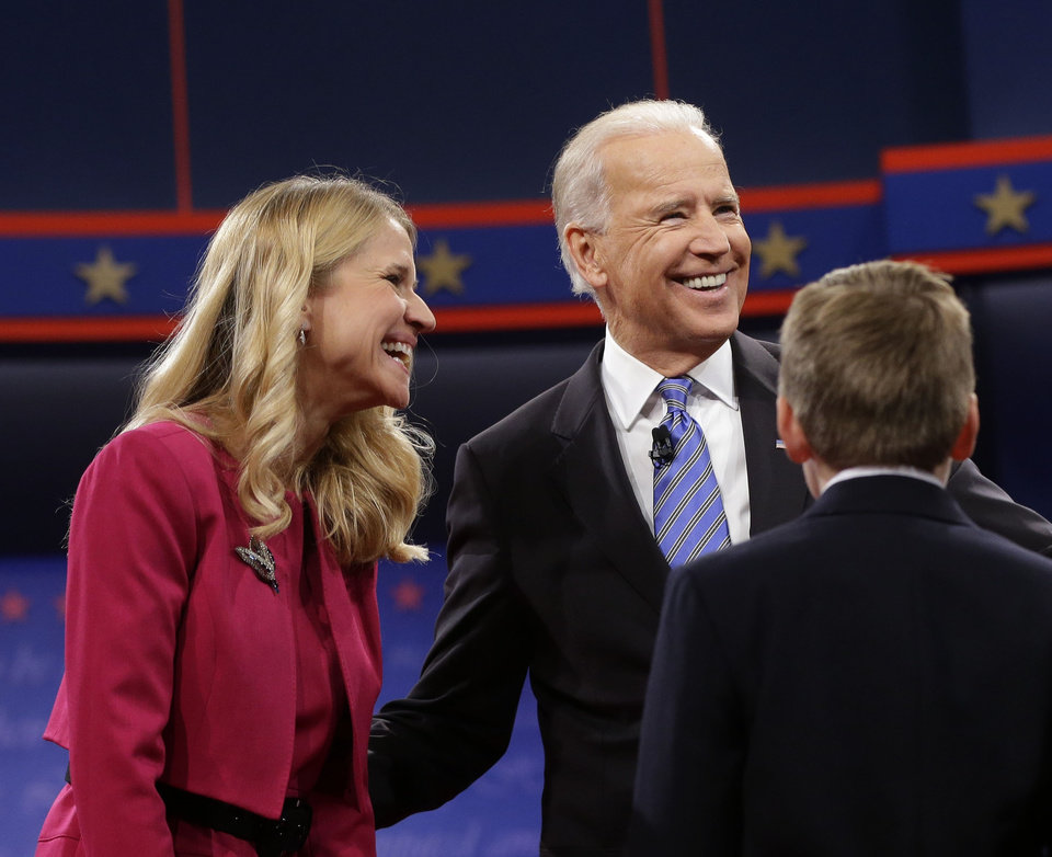 Photo -   Vice President Joe Biden, right, with Janna Ryan, left, wife of Republican vice presidential candidate, Rep. Paul Ryan, R-Wis., after the vice presidential debate, at Centre College in Danville, Ky., Thursday, Oct. 11, 2012. (AP Photo/Pablo Martinez Monsivais)
