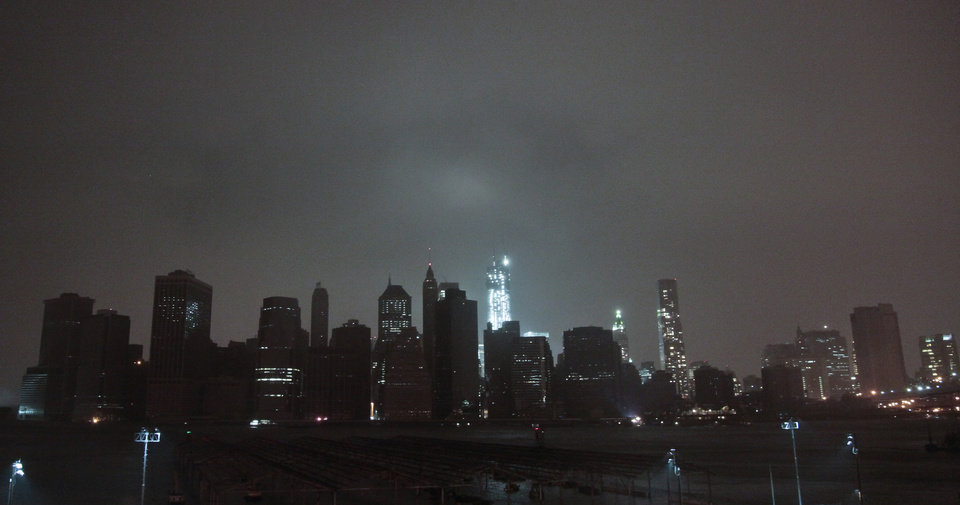 Photo -   Lower Manhattan goes dark during the hybrid storm Sandy, on Monday, Oct. 29, 2012, viewed from the Brooklyn borough of New York. Authorities warned that New York City and Long Island could get the worst of the storm surge: an 11-foot onslaught of seawater that could swamp lower areas of the city. (AP Photo/Bebeto Matthews)
