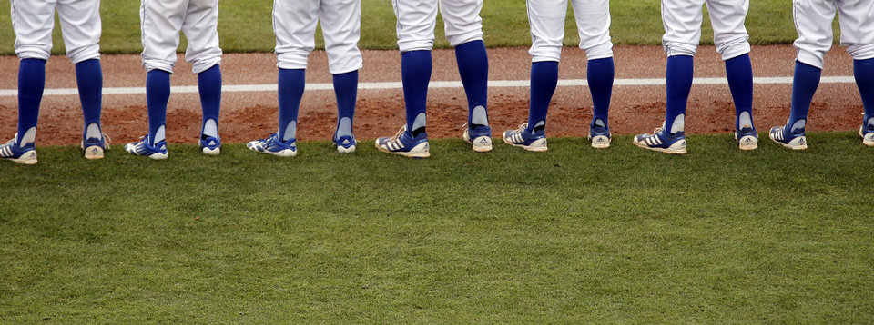 Members of the Kansas Jayhawks line up during team introductions in the Big 12 Championship baseball game between the University of Kansas Jayhawks (KU) and the University of Oklahoma Sooners (OU) at the Chickasaw Bircktown Ballpark on Sunday, May 26, 2013 in Oklahoma City, Okla.  Photo by Chris Landsberger, The Oklahoman