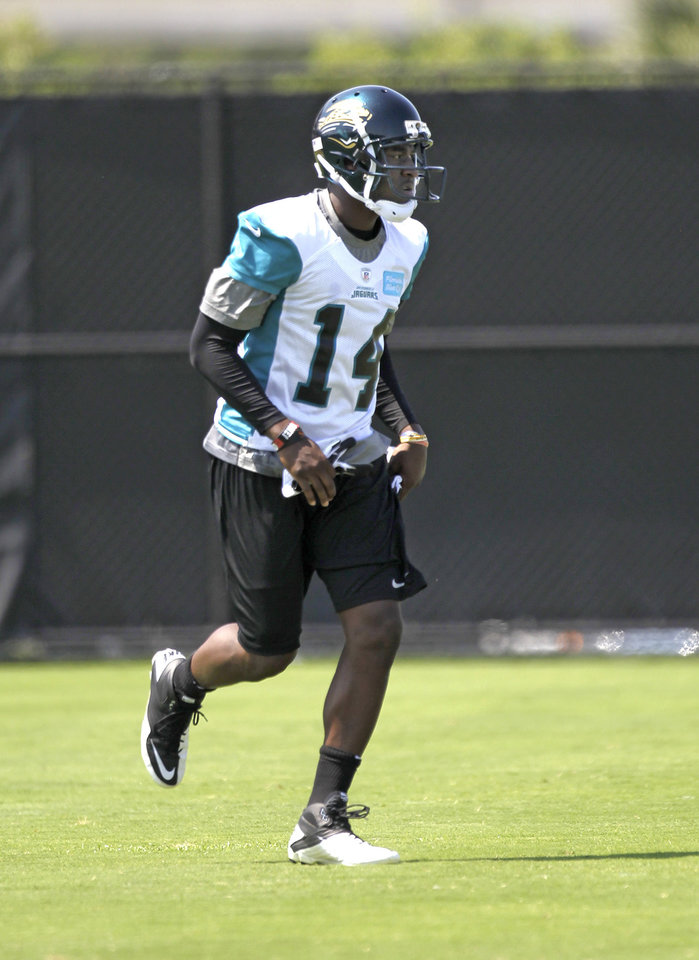 Jacksonville Jaguars wide receiver Justin Blackmon, a former OSU standout, practices in late May. Blackmon signed his rookie contract with the Jaguars on Monday and joined the team's mini camp. AP PHOTO