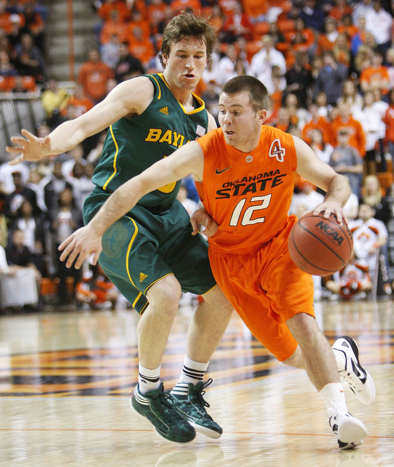 OSU's Keiton Page (12) drives the ball past Baylor's Brady Heslip (5) in the first half of a men's college basketball game between the Oklahoma State University Cowboys and the Baylor University Bears at Gallagher-Iba Arena in Stillwater, Okla., Saturday, Feb. 4, 2012. Photo by Nate Billings, The Oklahoman