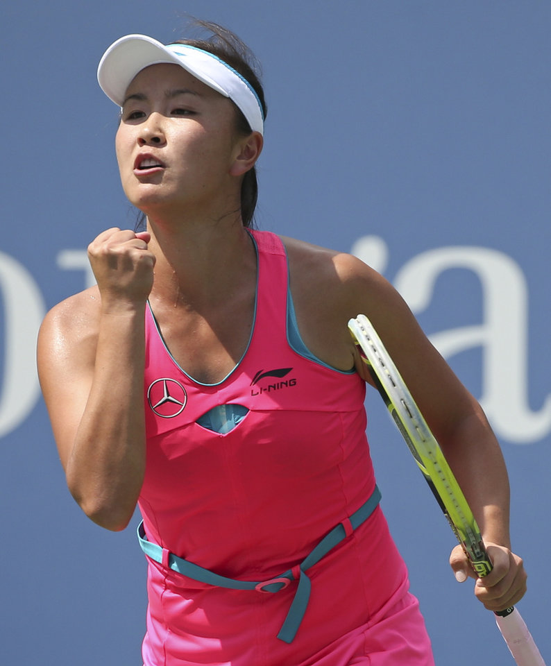Photo - Peng Shuai, of China, reacts after a shot against Belinda Bencic, of Switzerland, during the 2014 U.S. Open tennis tournament, Tuesday, Sept. 2, 2014, in New York. (AP Photo/Mike Groll)
