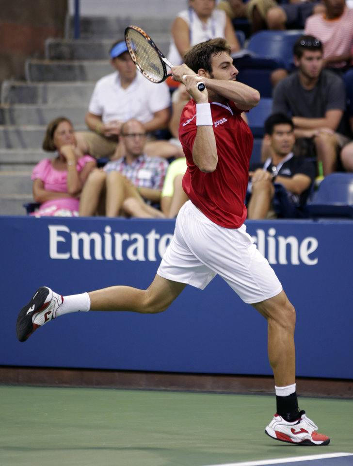 Photo - Marcel Granollers, of Spain, returns a shot against Tim Smyczek during the third round of the 2013 U.S. Open tennis tournament, Sunday, Sept. 1, 2013, in New York. (AP Photo/Kathy Willens)