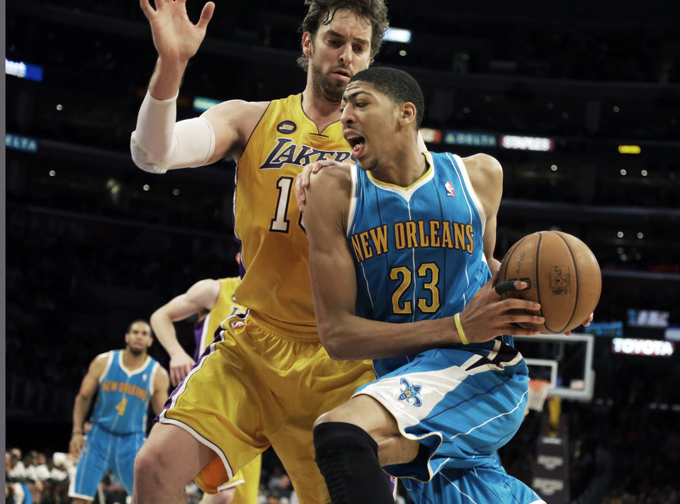 Photo - New Orleans Hornets forward Anthony Davis (23) drives against Los Angeles Lakers forward Pau Gasol (16), of Spain, in the first half of an NBA basketball game in Los Angeles Tuesday, April 9, 2013.  (AP Photo/Reed Saxon)