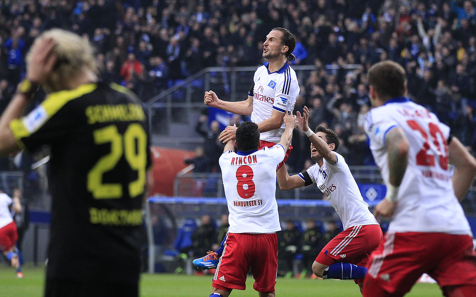 Photo - Hamburg's Petr Jiracek of Czech Republic, rear center, celebrates after scoring during the German first division Bundesliga soccer match between Hamburg SV and BvB Borussia Dortmund in Hamburg, Germany, Saturday, Feb. 22, 2014. (AP Photo/Frank Augstein)