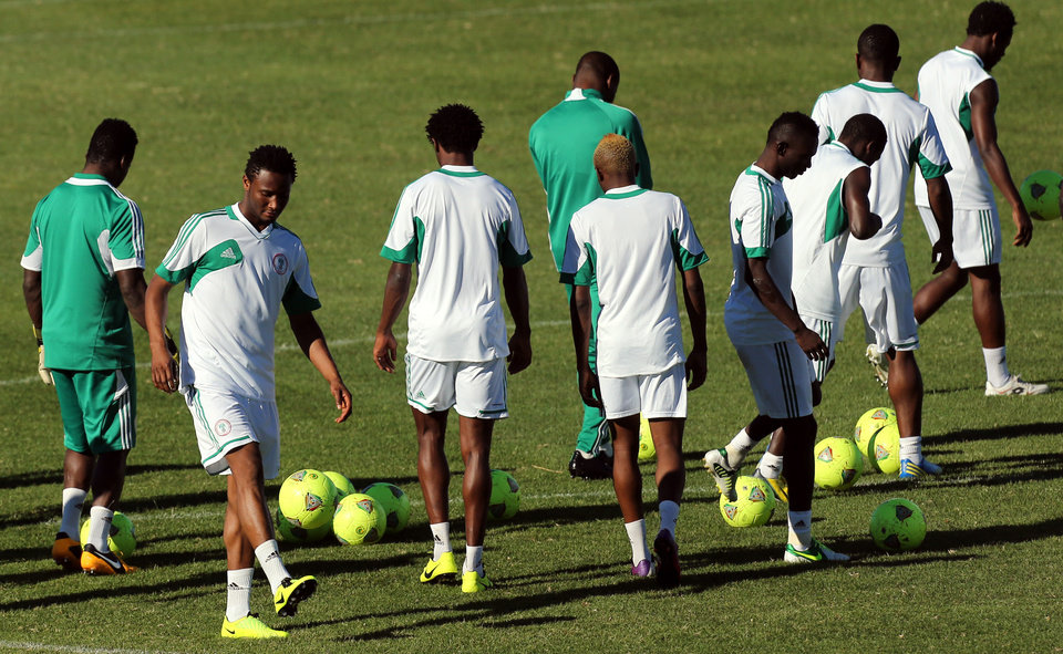 Nigeria's John Obi Mikel, second left, attends a training session with teammates in Nelspruit, South Africa, Thursday Jan. 24, 2013, ahead of their African Cup of Nations Group C soccer match against Zambia on Friday. (AP Photo/Themba Hadebe)