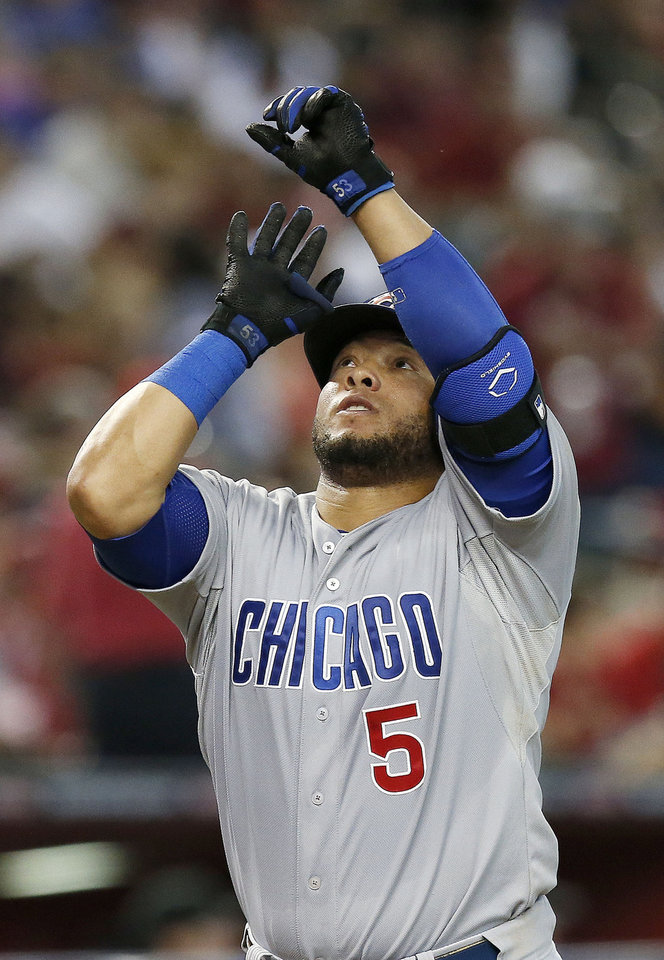 Photo - Chicago Cubs' Welington Castillo celebrates his home run against the Arizona Diamondbacks during the fourth inning of a baseball game on Saturday, July 19, 2014, in Phoenix. (AP Photo/Ross D. Franklin)