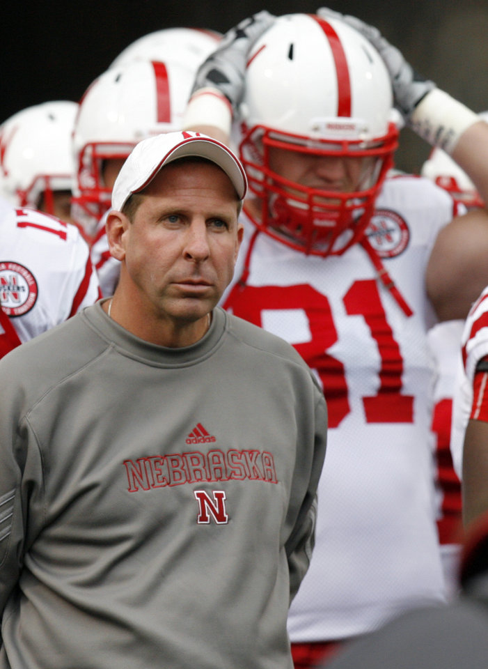 Photo - Nebraska head coach Bo Pelini stands with his team before the college football game between the Oklahoma State Cowboys (OSU) and the Nebraska Huskers (NU) at Boone Pickens Stadium in Stillwater, Okla., Saturday, Oct. 23, 2010. Photo by Nate Billings, The Oklahoman
