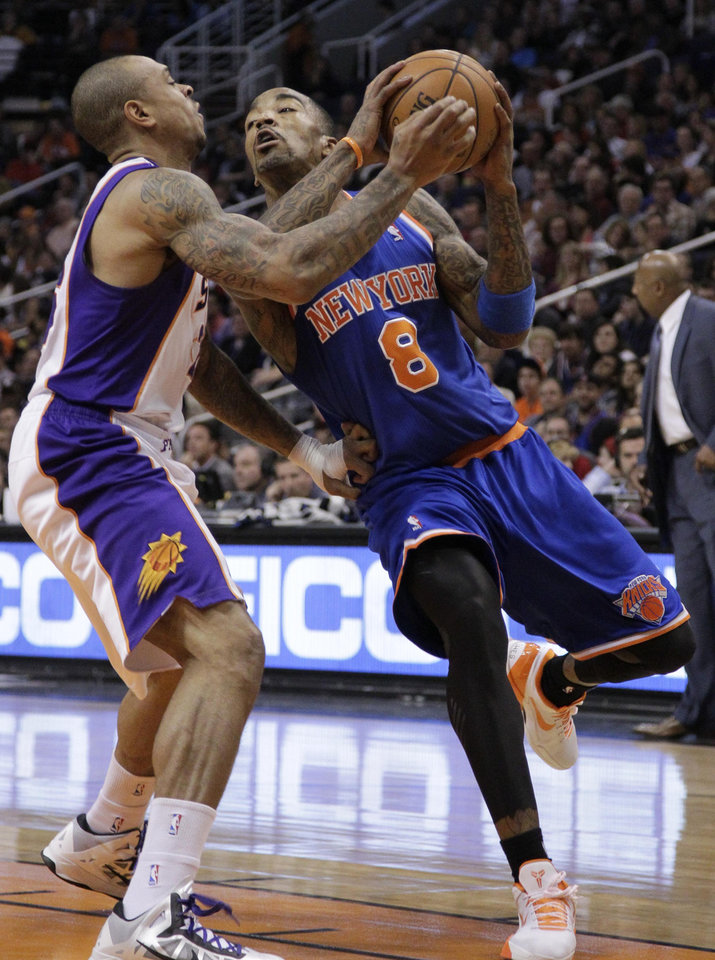 New York Knicks' J.R. Smith (8) drives against Phoenix Suns' Shannon Brown during the first half of an NBA basketball game on Wednesday, Dec. 26, 2012, in Phoenix. (AP Photo/Matt York)