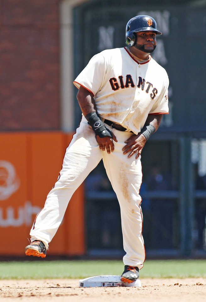 Photo - San Francisco Giants' Pablo Sandoval lifts his leg upon advancing tho second base on a wild pitch during the fourth inning of a baseball game against the Chicago Cubs, Wednesday, May 28, 2014, in San Francisco. (AP Photo/George Nikitin)