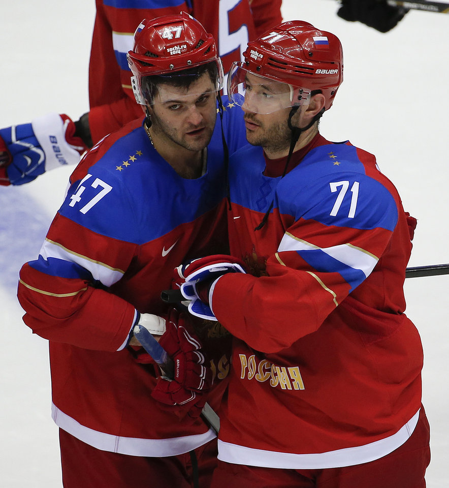 Photo - Russia forward Ilya Kovalchuk, right, is congratulated by Russia forward Alexander Radulov after hitting the winning shot in a shootout against Slovakia during a men's ice hockey game at the 2014 Winter Olympics, Sunday, Feb. 16, 2014, in Sochi, Russia. Russia won 1-0.  (AP Photo/Julio Cortez)