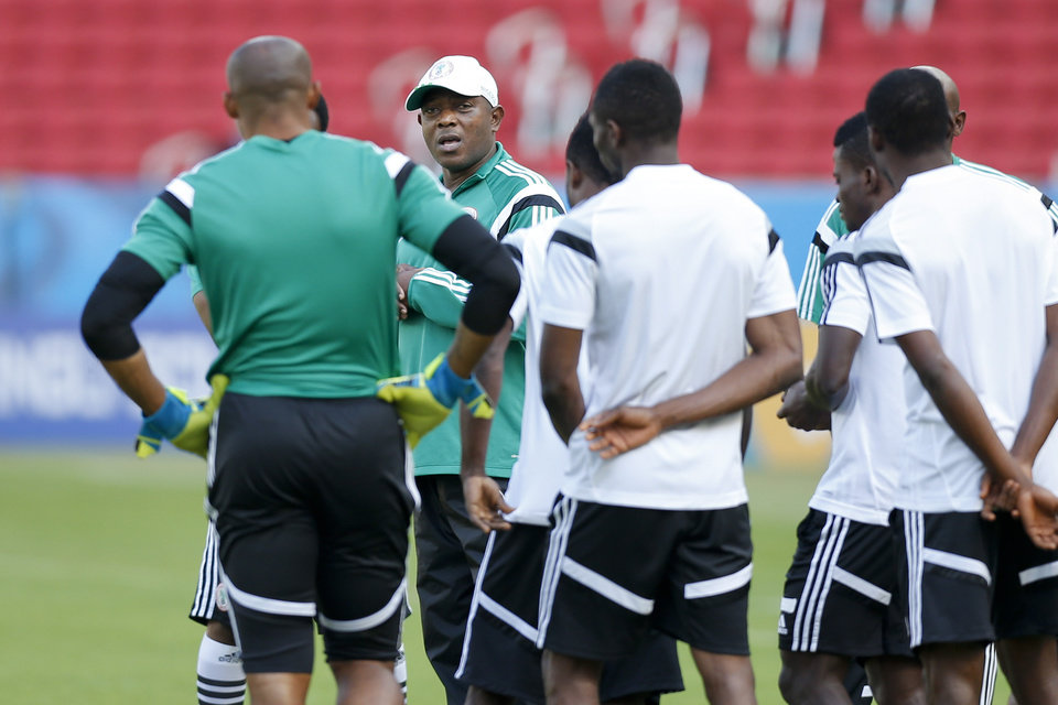 Photo - Nigeria's coach Stephen Keshi, second left, speaks to players at the start of a training session at Beira-Rio Stadium in Porto Alegre, Brazil, Tuesday, June 24, 2014.  Nigeria plays in group F of the 2014 soccer World Cup. (AP Photo/Victor R. Caivano)