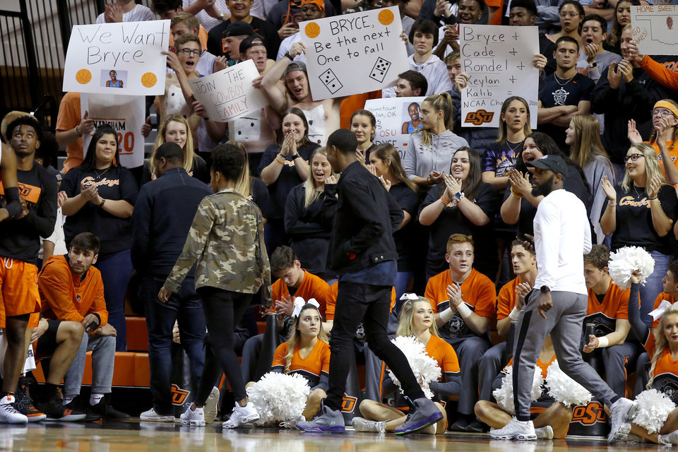 Photo - Oklahoma State fans cheer for Bryce Thompson as he walks by during an NCAA basketball game between the Oklahoma State University Cowboys (OSU) and the Oral Roberts Golden Eagles (ORU) at Gallagher-Iba Arena in Stillwater, Okla., Wednesday, Nov. 6, 2019. [Bryan Terry/The Oklahoman]