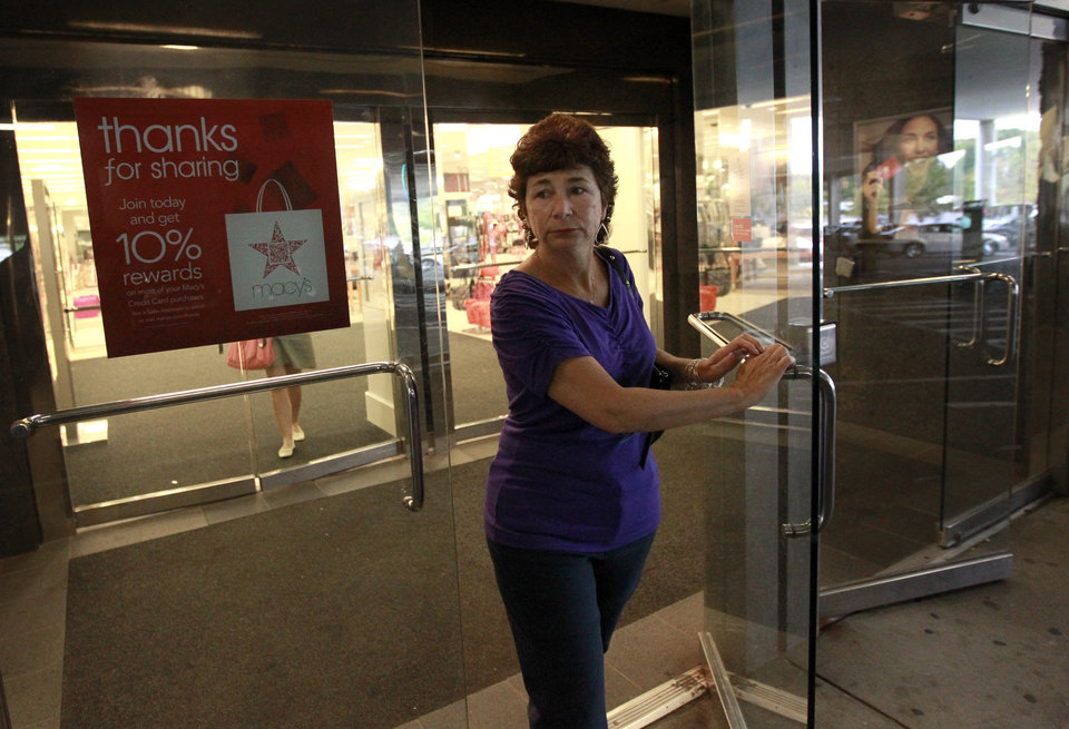Photo -   In this Thursday, Oct. 4, 2012 photo retiree Jamie Reilly, of North Providence, R.I., departs a department store in North Attleboro, Mass. Reilly left her job as a secretary at age 50, thinking her 30 years of state employment would mean good benefits during her later years. But now she said she may be forced to re-enter the workforce at age 55 because the state has put off pension increases. (AP Photo/Steven Senne)