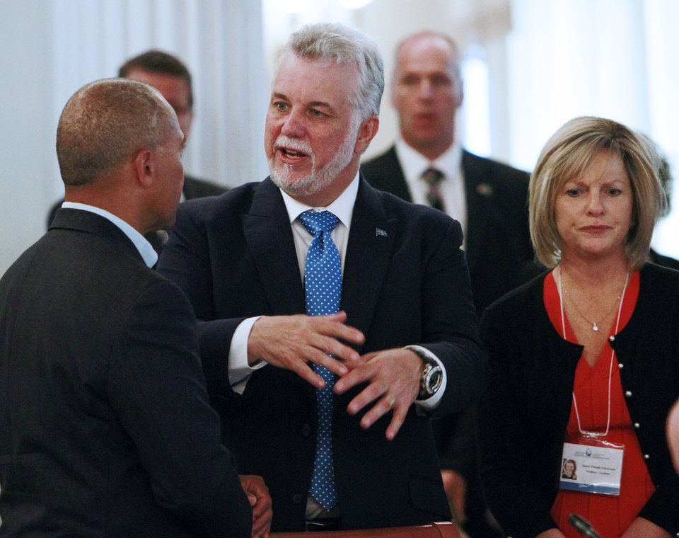 Photo - Premier Philippe Couillard of Quebec speaks with Massachusetts Gov. Deval Patrick at the New England Governors and eastern  Canadian Premiers 38th annual conference Monday, July 14, 2014, in Bretton Woods, N.H. They are wrapping up a two-day meeting in New Hampshire focused on regional cooperation.(AP Photo/Jim Cole)