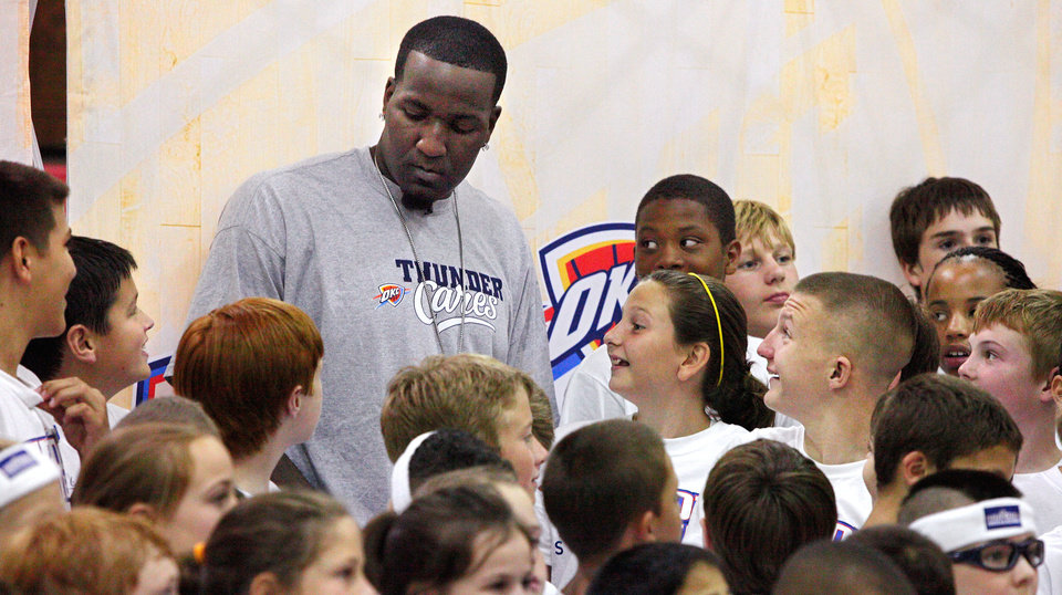 Oklahoma City Thunder NBA basketball player Kendrick Perkins surrounded by camp participants after posing for a group photograph at a Thunder Youth Camp at Mid-America Christian University, Monday,  June 6, 2011.  Photo by Jim Beckel, The Oklahoman ORG XMIT: KOD