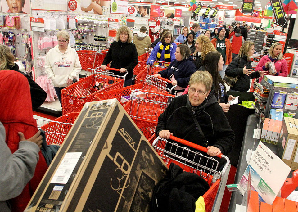 Photo -   A sea of people gather near the electronics section at Target just minutes after the doors open in Muskegon, on Thursday Nov. 22, 2012. (AP Photo/The Chronicle-mlive.com, Libby March)