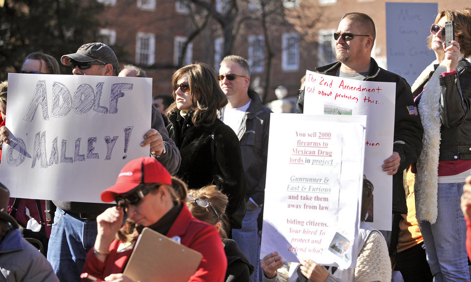Protesters hold up signs during a protest against Governor Martin O'Malley's new gun control legislation at Lawyers Mall in Annapolis, Saturday, Jan. 19, 2013.  Rallies are being held by gun rights advocates four days after President Barack Obama unveiled a sweeping plan to curb gun violence. (AP Photo/Capital Gazette, Matthew Cole)