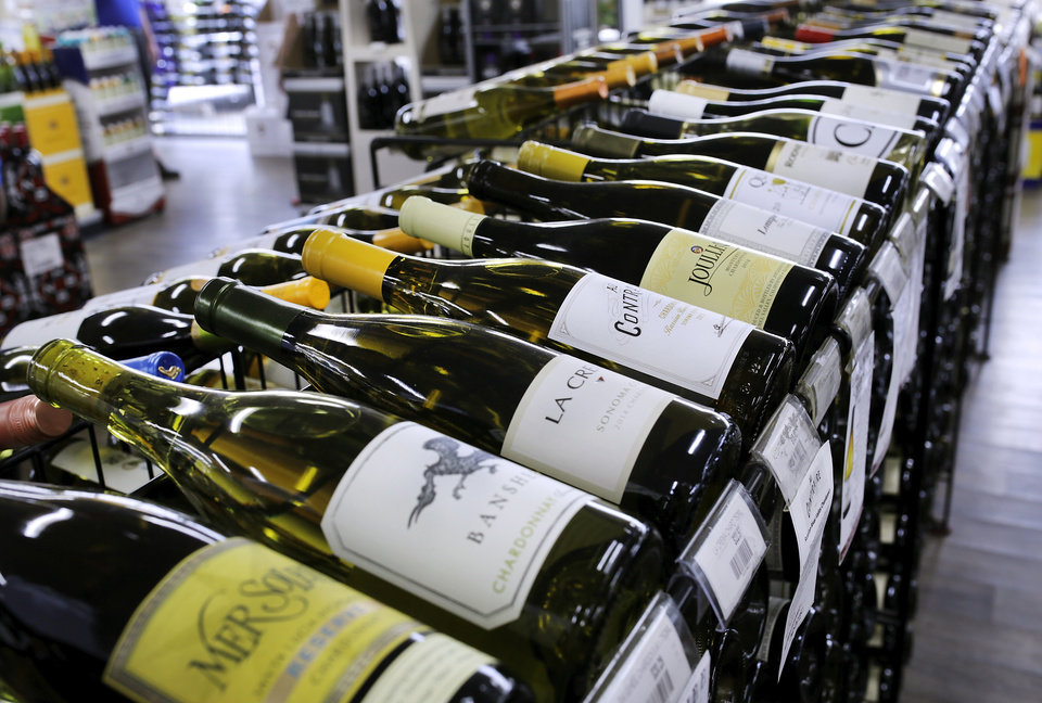 Photo -  Wine is on display at Byron's Liquor Warehouse in Oklahoma City. Oklahoma voters passed State Question 792 in November, allowing grocers to sell wine in 2018. [Photo by Jim Beckel, The Oklahoman]
