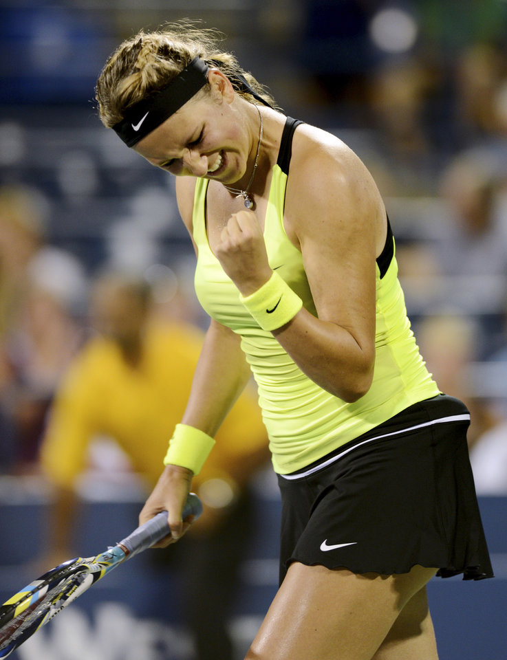 Photo -   Victoria Azarenka, of Belarus, celebrates her 6-2, 6-2 win over Anna Tatishvili, of Georgia, in the fourth round of play at the U.S. Open tennis tournament, Sunday, Sept. 2, 2012, in New York. (AP Photo/Henny Ray Abrams)