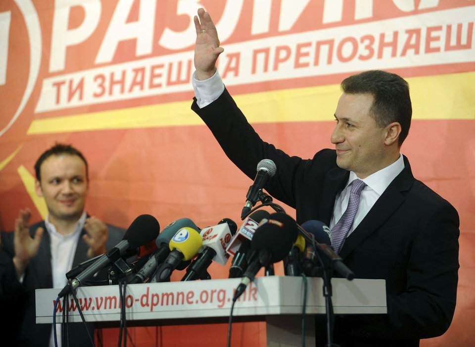 Photo - Macedonian Prime Minister and leader of the ruling conservative VMRO-DPMNE Nikola Gruevski greets his supporters while announcing a double victory in parliamentary and presidential elections, in Skopje, Macedonia, early Monday, April 28, 2014. Macedonia's incumbent prime minister claimed a landslide victory late Sunday in parliamentary and presidential elections, but the center-left opposition denounced what it called distorting interference in the democratic process by the ruling party and said it won't recognize the results. (AP Photo/Boris Grdanoski)
