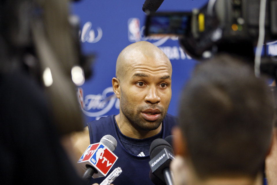 Photo - Oklahoma City's Derek Fisher answers a question during media and practice day for the NBA Finals between the Oklahoma City Thunder and the Miami Heat at the Chesapeake Energy Arena in Oklahoma City, Monday, June 11, 2012. Photo by Nate Billings, The Oklahoman