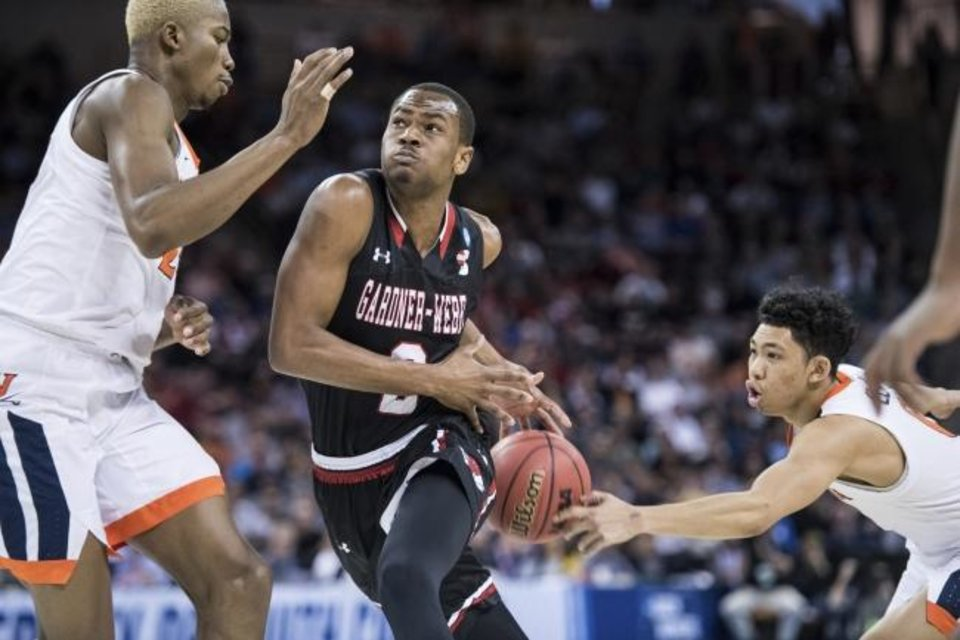 Photo -  Virginia's Kihei Clark, right, strips the ball from Gardner Webb's Eric Jamison Jr. (2) during the Cavaliers' 71-56 win Friday in the first round of the NCAA Tournament in Columbia, S.C. [AP Photo/Sean Rayford]