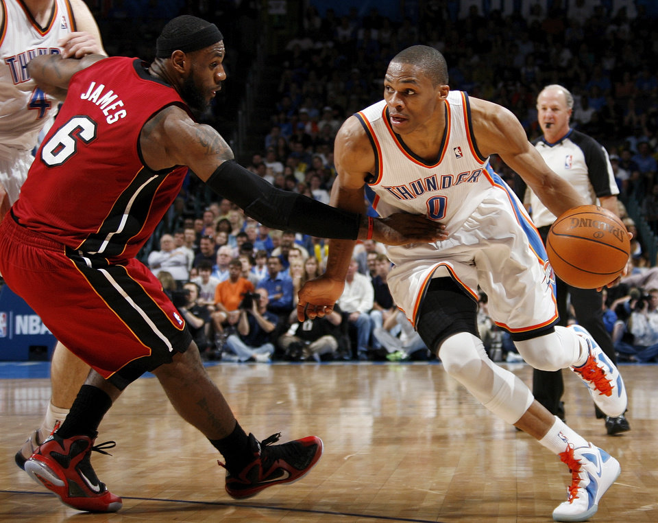 Photo - Oklahoma City's Russell Westbrook (0) drives the ball on Miami's LeBron James (6) during the NBA basketball game between the Miami Heat and the Oklahoma City Thunder at Chesapeake Energy Arena in Oklahoma City, Sunday, March 25, 2012. Oklahoma City won, 103-87. Photo by Nate Billings, The Oklahoman