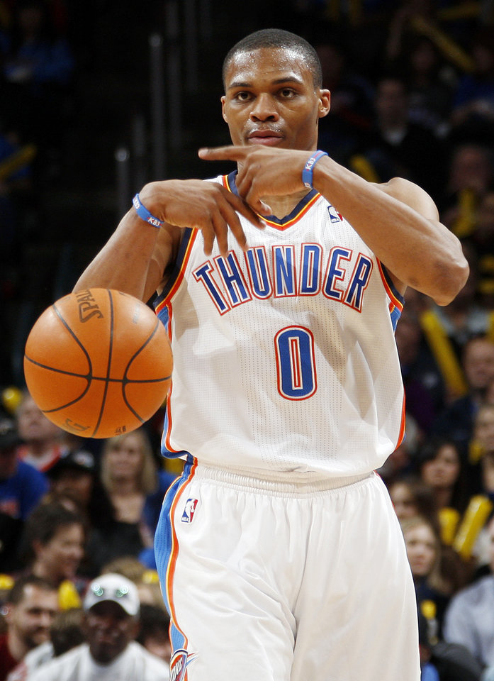 Photo - Russell Westbrook (0) of Oklahoma City signals his teammates in the third quarter during the NBA basketball game between the Oklahoma City Thunder and Phoenix Suns at Chesapeake Energy Arena in Oklahoma City, Saturday, Dec. 31, 2011. Oklahoma City won, 107-97. Photo by Nate Billings, The Oklahoman