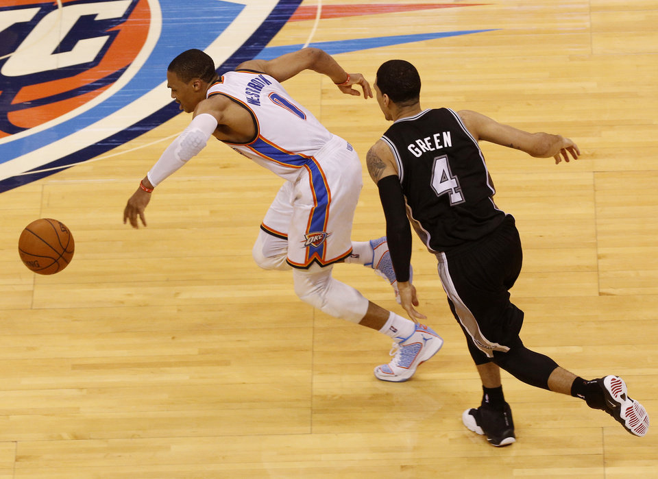 Oklahoma City Thunder guard Russell Westbrook (0) steals the ball from San Antonio Spurs guard Danny Green (4) in the first half of Game 4 of the Western Conference finals NBA basketball playoff series in Oklahoma City, Tuesday, May 27, 2014. (AP Photo/Garett Fisbeck)
