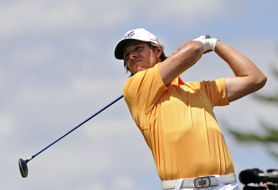 Photo - Aaron Baddeley, of Australia, watches his drive on the second hole during the final round of the Travelers Championship golf tournament in Cromwell, Conn., Sunday, June 22, 2014. (AP Photo/Fred Beckham)